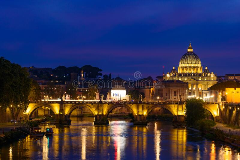 Night view of St. Peter`s Basilica and Ponte Sant`Angelo in Rome, Italy royalty free stock photos