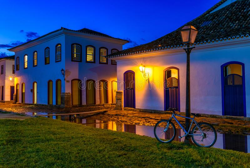 Night view of street of historical center in Paraty, Rio de Janeiro, Brazil. Paraty is a preserved Portuguese colonial and Brazilian Imperial municipality stock image