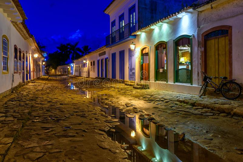 Night view of street of historical center in Paraty, Rio de Janeiro, Brazil. Paraty is a preserved Portuguese colonial and Brazilian Imperial municipality stock images