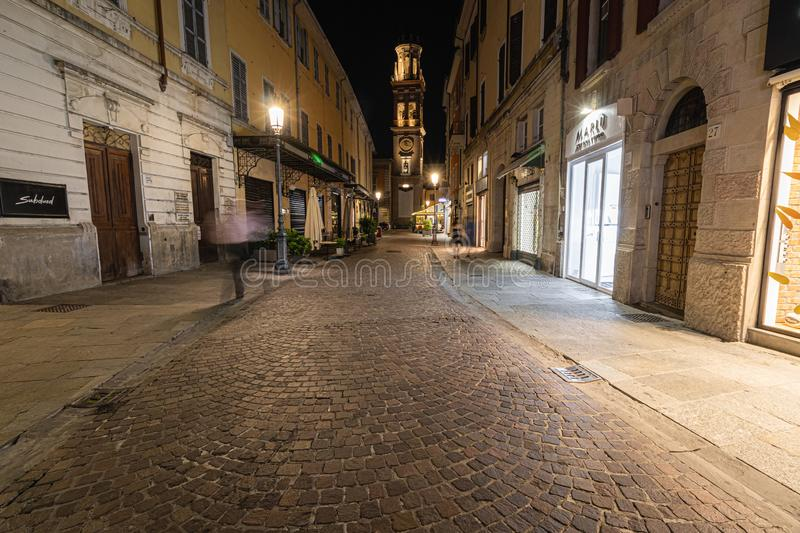 Night view of a street in Parma city center leading to a bell towers stock photo