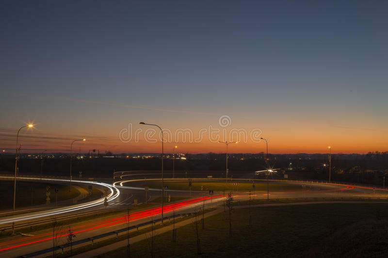 Night view street tracers with magic sunset in Latvia Daugavpils city. This is Latgales street and Vidzemes street ring road tracers. The beautiful colorful stock photography