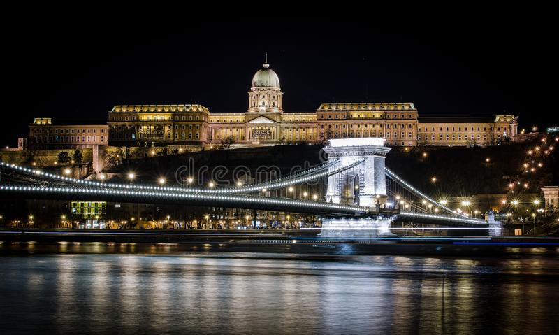 Night view of the Szechenyi Chain Bridge in Budapest, Hungary. Night view of the Szechenyi Chain Bridge is a suspension bridge that spans the River Danube stock photo