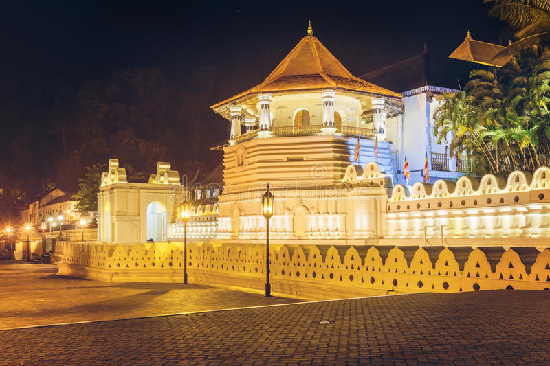 Night view of the Temple of the Buddha Tooth with lights, Kandy. Night view of the Temple of the Buddha Tooth with lights. Kandy, Sri Lanka, Asia stock photography