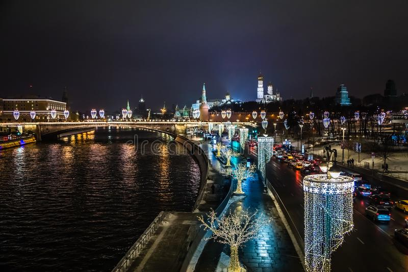 Night view to Moscow Kremlin and river banks decorated with NY i stock photo