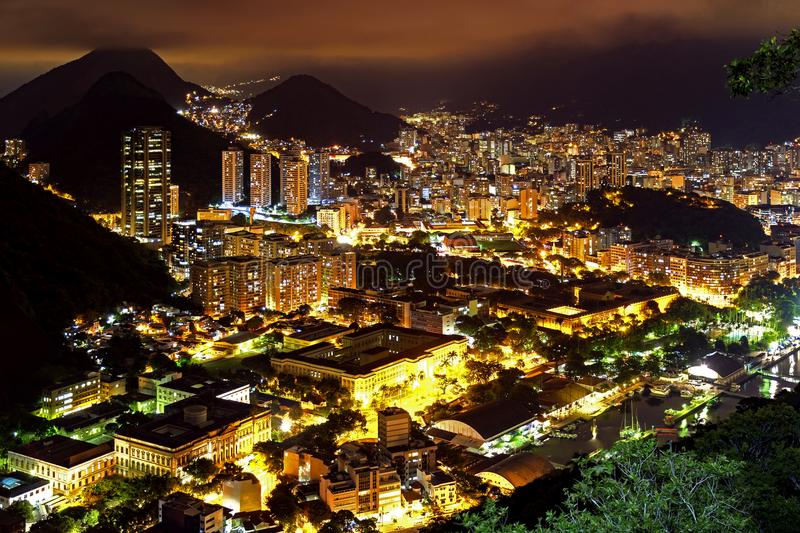 Night view of the top of the Botafogo neighborhood in Rio de Janeiro. With city lights, hills and slums lit up on a summer night stock image
