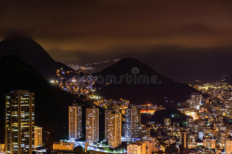 Night view of the top of the Botafogo neighborhood in Rio de Janeiro. With city lights, hills and slums lit up on a summer night royalty free stock images