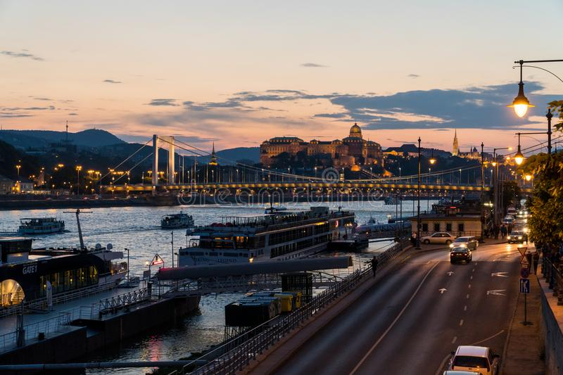 Night view and transport on a Liberty bridge over the Danube riv royalty free stock photo