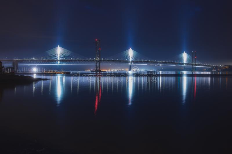 Night view of two bridges over the sea bay. Forth Road Bridge and Queensferry Crossing, Scotland, United Kingdom royalty free stock image