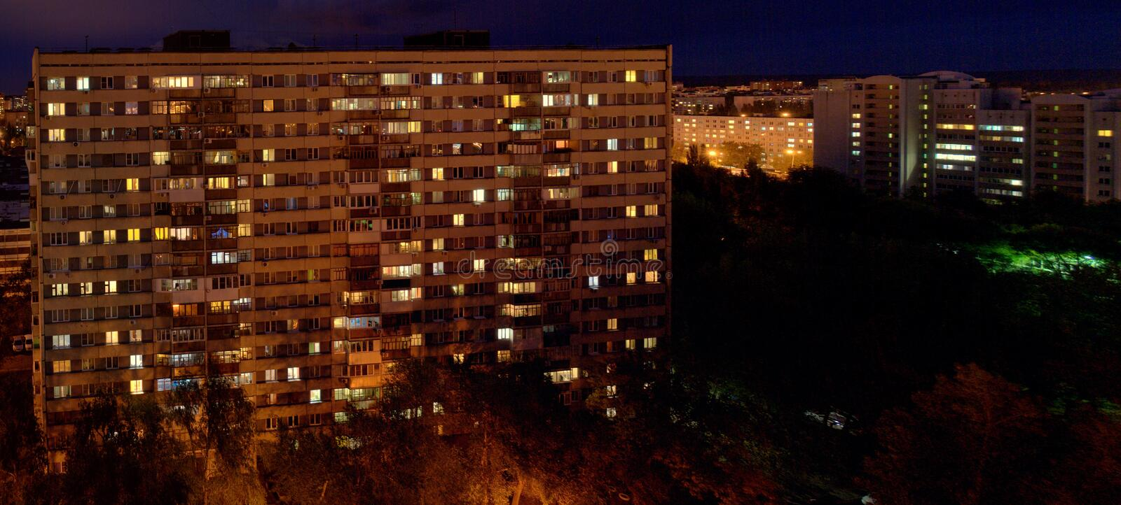 Night view of the two-storied 16-storey residential building with many glowing windows in the city of Togliatti. Night view of the two-storied 16-storey royalty free stock image