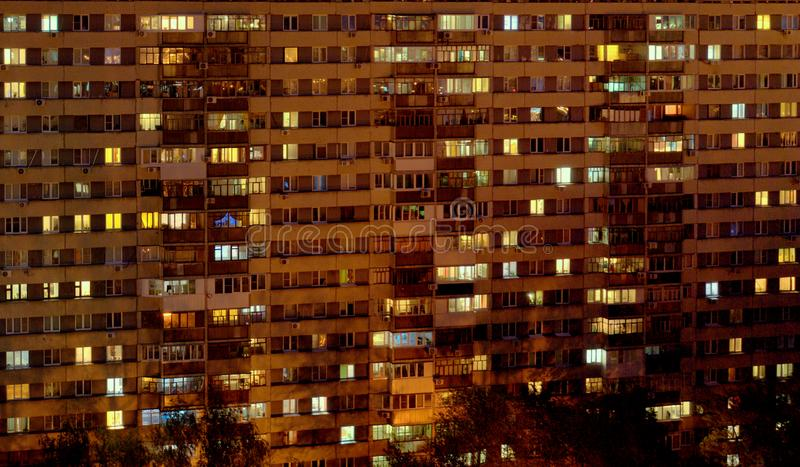 Night view of the two-storied 16-storey residential building with many glowing windows in the city of Togliatti. Night view of the two-storied 16-storey stock image