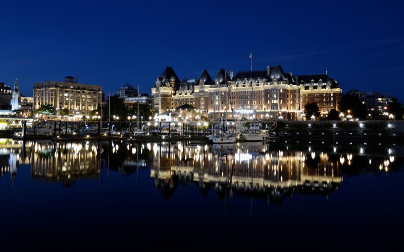Night view of Victoria city, buildings are reflected in the water stock images
