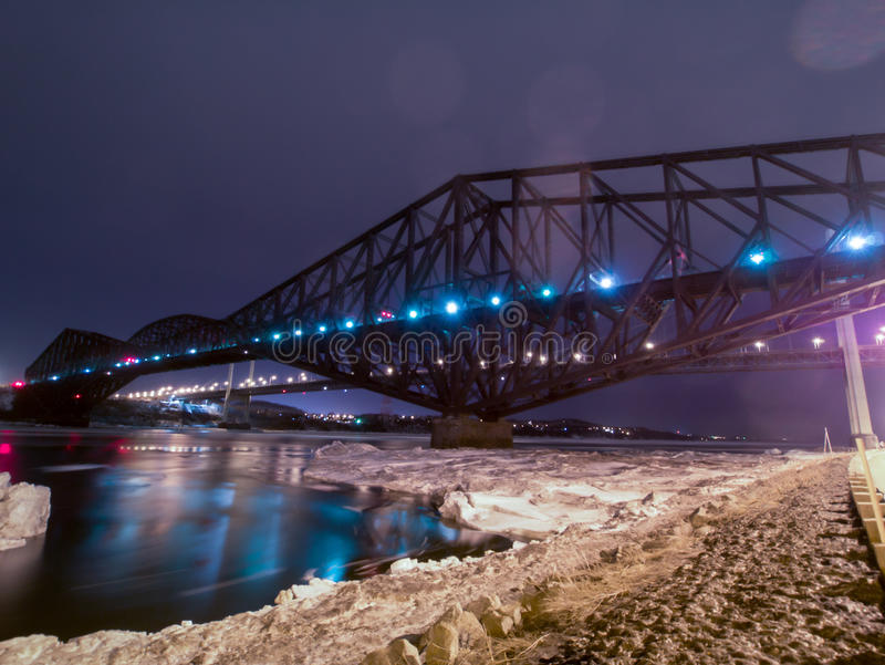 Pont de Quebec and Pierre-Laporte Bridge in Quebec city. Night view in winter of the Quebec city bridge, the longest cantilever bridge built in 1917 stock images