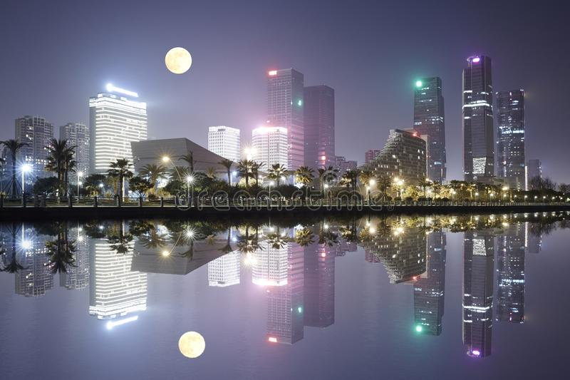 City skyline, Xiamen, China. Night view of Xiamen Central Business District and full moon, Fujian, China stock image