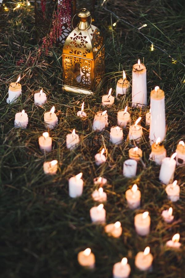 Night wedding ceremony with vintage lamps on tree stock photo