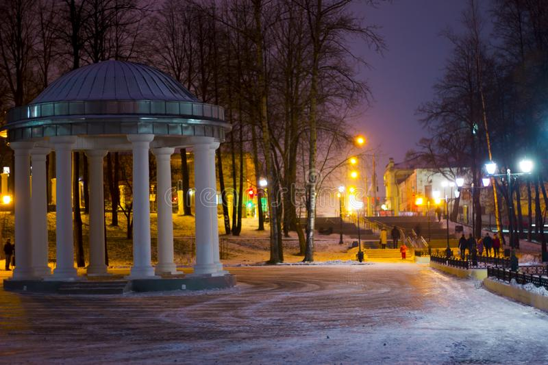 Night winter landscape in the alley of city park. Classical rotunda royalty free stock photo