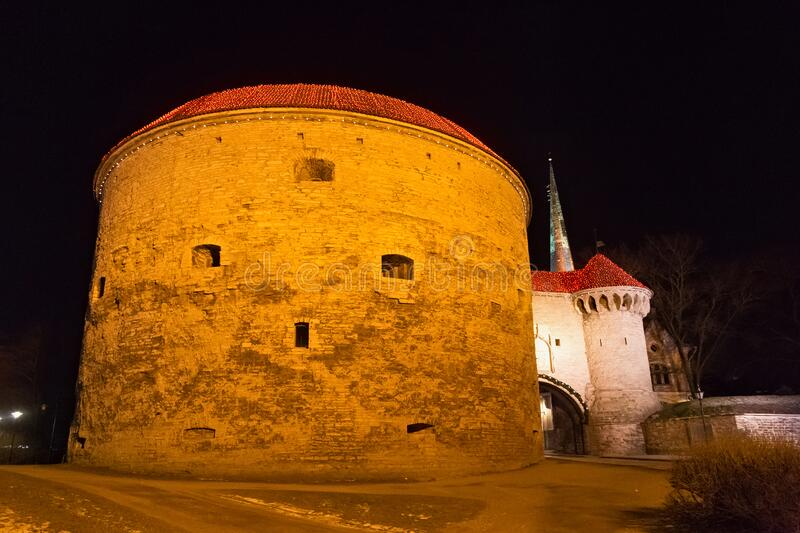 Night winter view of the famous medieval Fat Margaret Tower in historical part of Tallinn. royalty free stock images