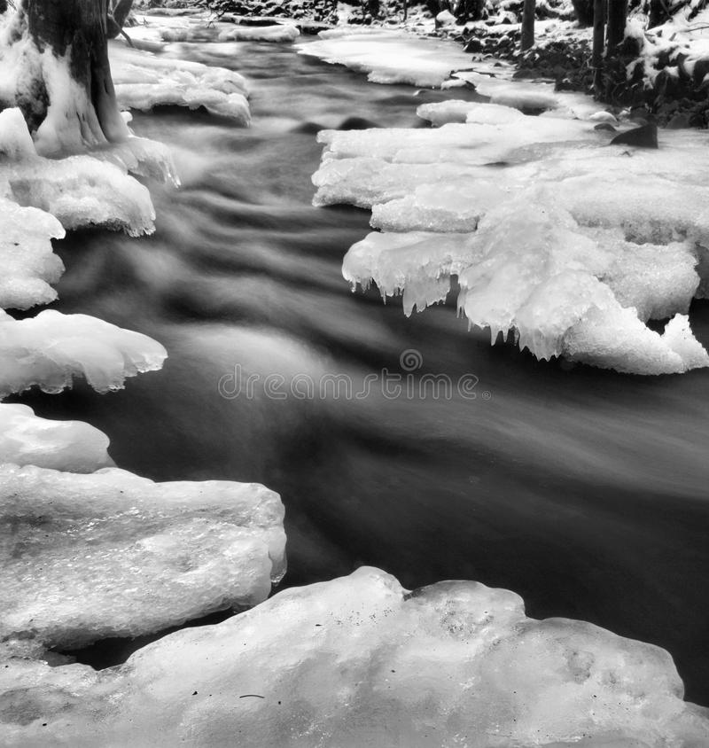 Free Night Winter View To Frozen Brook, Icy Twigs And Icy Boulders Above Rapid Stream. Reflections Of Light In Icicles. Black And White Royalty Free Stock Photos - 35092298