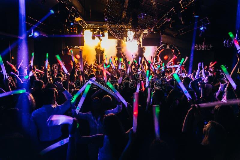 Nightclub crowd dancing stock images