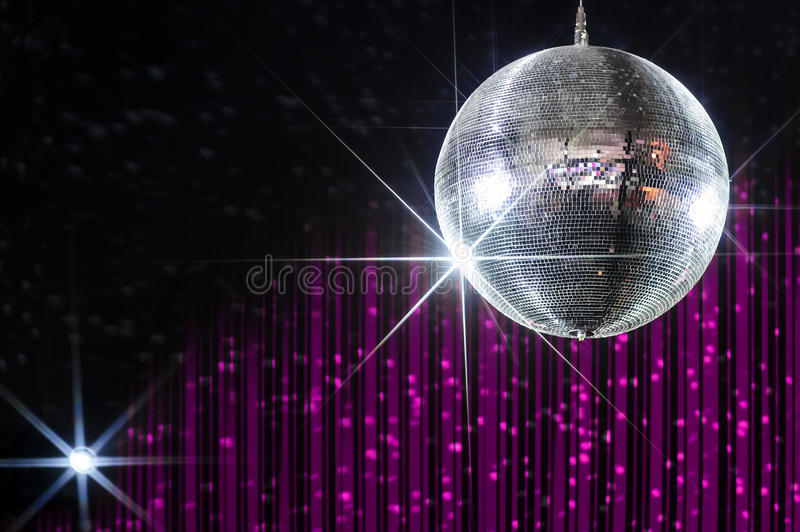 Nightclub disco ball. Party disco ball with stars in nightclub with striped pink and black walls lit by spotlight, nightlife entertainment industry stock photo