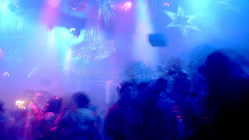 Nightclub Scene. With christmas decor and dance floor crowd in motion