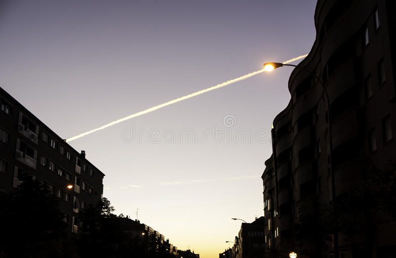 Nightfall in city. With lampposts, construction and landscape royalty free stock photo