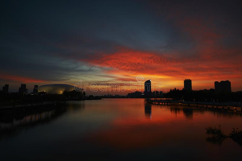 Nightfall on the lake. Nightfall of the lake in a moden city of China stock photo