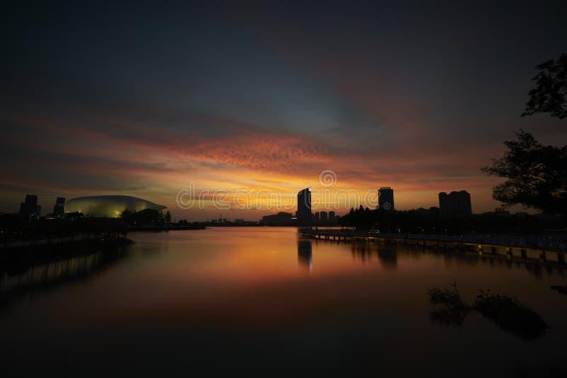 Nightfall on the lake. Nightfall of the lake in a moden city of China stock photos