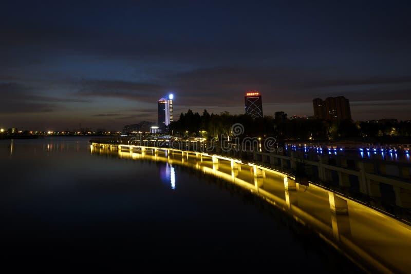Nightfall on the lake. Nightfall of the lake in a moden city of China stock photography