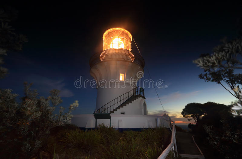 Nightfall at Sugarloaf Point Lighthouse. Nightfall and last light on the horizon at Sugarloaf Point Lighthouse at Seal Rocks Australia stock image
