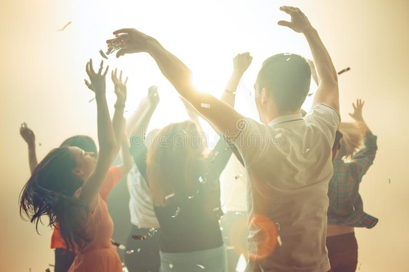 Nightlife and disco concept. Young people are dancing in club. stock image