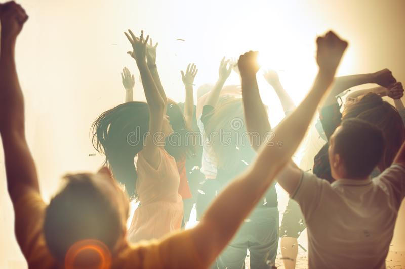 Nightlife and disco concept. Young people are dancing in club. royalty free stock images