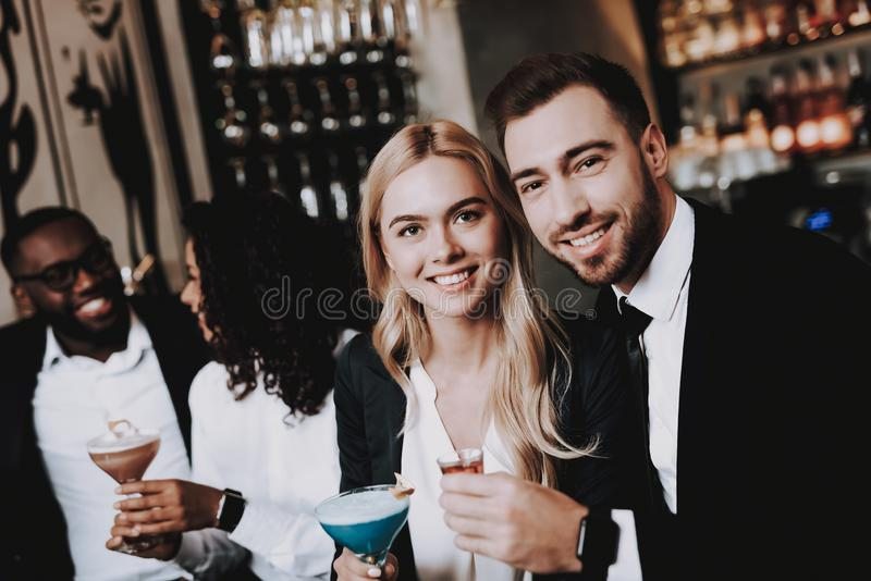 Nightlife. Girls. Guys. Drink Alcoholic Beverages. royalty free stock photos