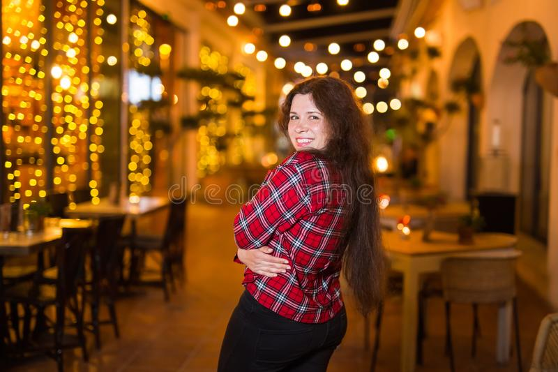 Nightlife, party and lifestyle concept - Girl walking in night city royalty free stock photo