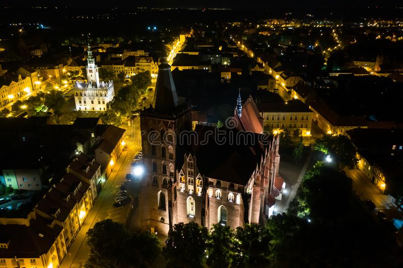 Nightly aerial view of Gothic church and Time Square in an old town in Europe stock photos