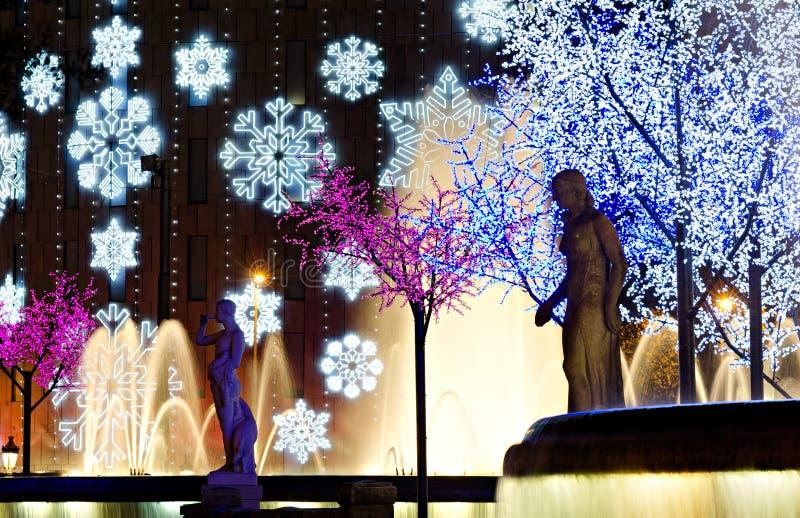 Nightly colorful christmas illumination. Plaza Catalunya, Barcelona, Spain stock photo