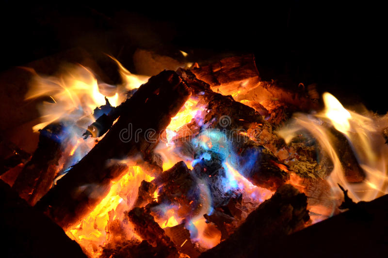 The nightly fire. In the fire can be seen the coal burnt wood and amazing lights royalty free stock photo