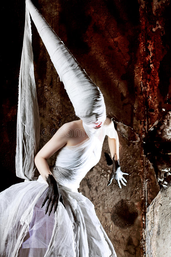 Nightmare. Shot of a twilight girl in white dress. Halloween, horror stock images