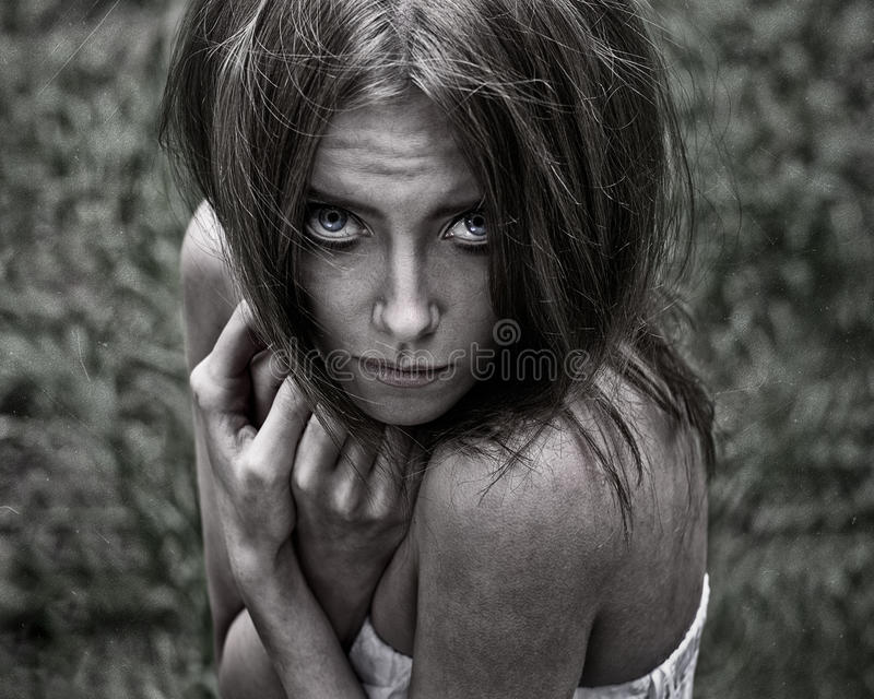 Nightmare and Halloween theme: portrait of scary girl witch in the woods stock images