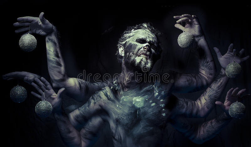 Nightmare, man in mud with six arms stock photography