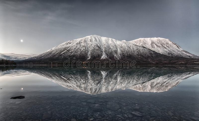 Nights Reflection. This is a reflection off of Kenai Lake in Cooper Landing, Alaska, USA stock image