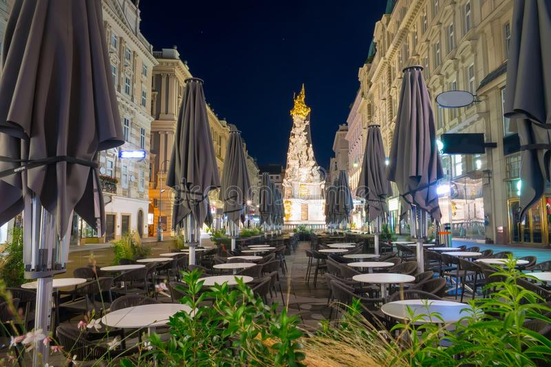 Nightscape of Graben street with street cafe and Plague Column, Austria, Vienna royalty free stock photos