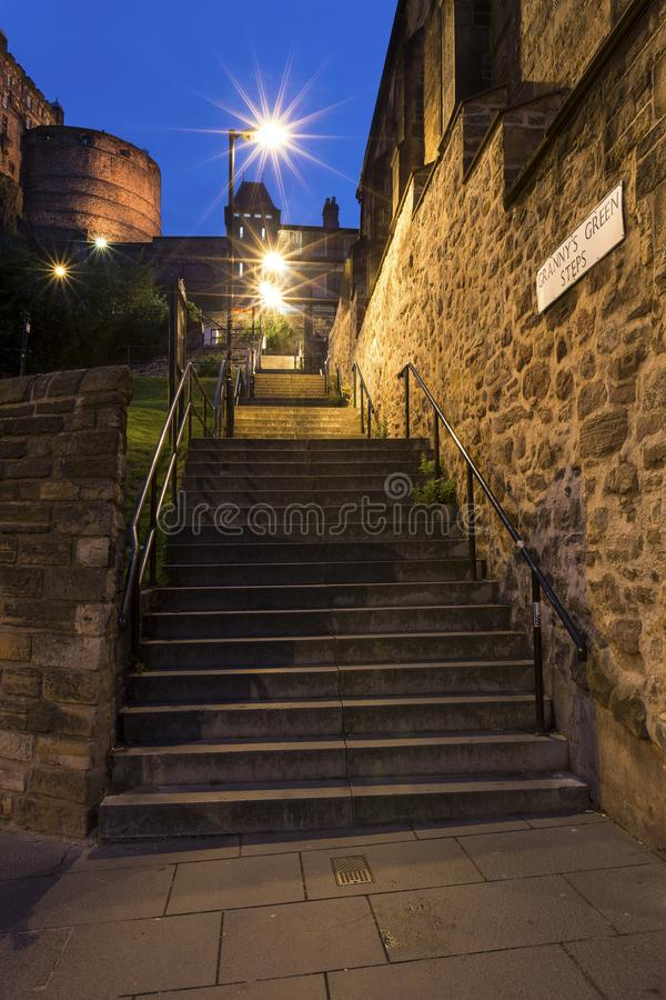 Nightscape of steps in streets of Edinburgh with starburst lights royalty free stock images