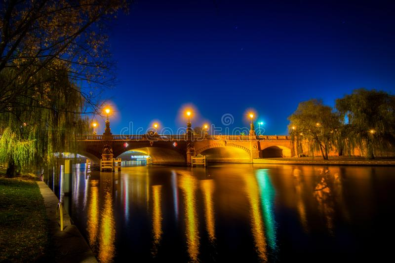 Nightshot of the Berlin Moltke bridge over the river Spree. With colourful reflections in the water stock photography