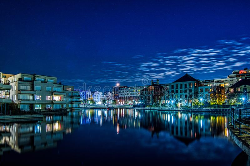 Nightshot of the Humboldt harbour in Berlin Tegel. With illuminated houses and reflections on the water surface stock photo