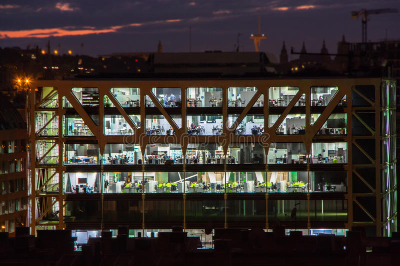 Nightshot of an office building in Barcelona, Spain. Nightshot of an office building in Barcelona. People working stock photography
