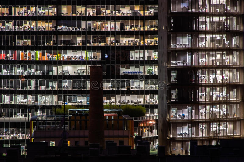 Nightshot of two office buildings in Barcelona, Spain. Nightshot of two office buildings in Barcelona. People working royalty free stock images
