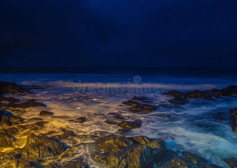 Nightshot of the waves and rocks at the indian ocean at the Wild Coast. In South Africa royalty free stock photo