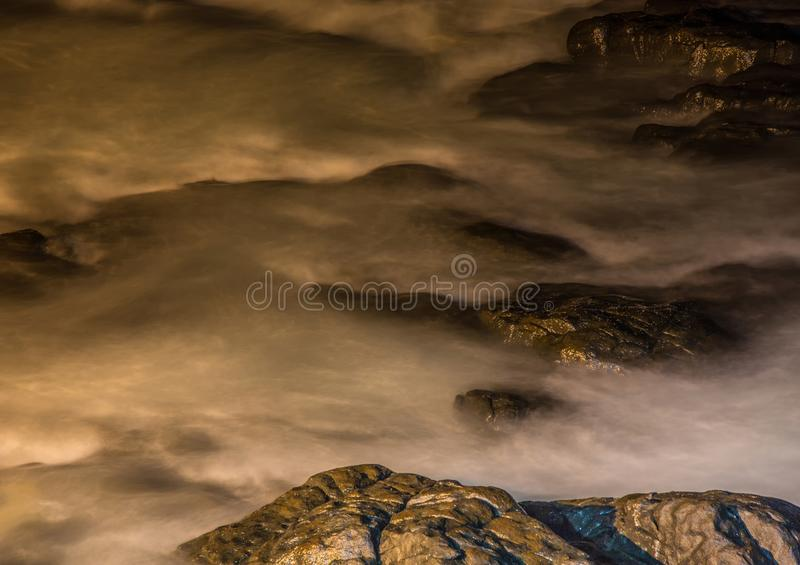 Nightshot of the waves and rocks at the indian ocean at the Wild Coast. In South Africa stock images
