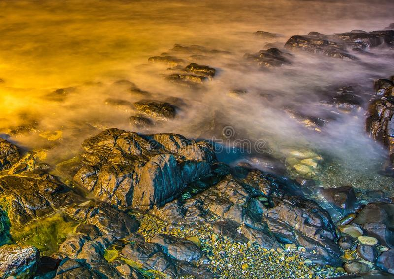 Nightshot of the waves and rocks at the indian ocean at the Wild Coast. In South Africa stock image