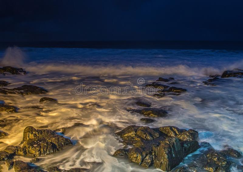 Nightshot of the waves and rocks at the indian ocean at the Wild Coast. In South Africa stock photos